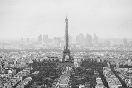 Photo sur Toile Europe Centrale View of the streets of Paris from the heights. Travel through Europe. Attractions in France. Cloudy Paris. Clouds in the sky. Eiffel Tower