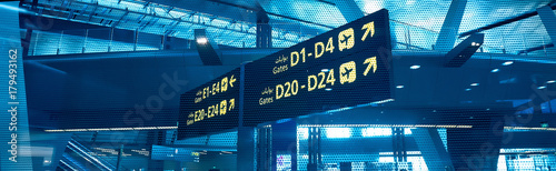 Gates D and E. Sign in airport. Interior of the airport..