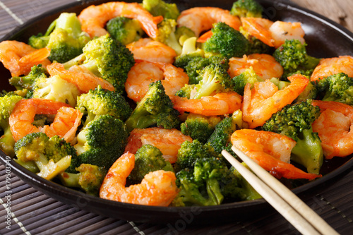 Fried shrimp with broccoli and garlic close-up. horizontal