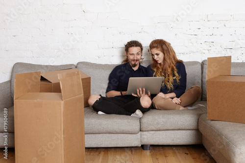 Cool young man and woman couple choosing furniture for new ...