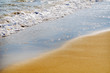 close up of the sea water affecting the sand on the beach, sea waves calmly flowing sand, relaxing view