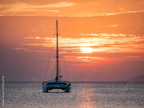 Sailing Boat and Catamaran at Sunset Canvas Print