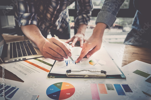 Fototapeta Business team support and meeting concept. Group of Investor working and pointing at financial paperwork Finance task. obraz