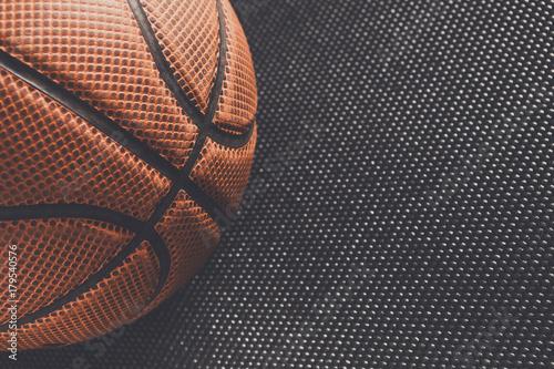 Fotografía  Old basketball ball on black background copy space