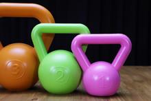 Pink, Green, And Orange Kettlebells