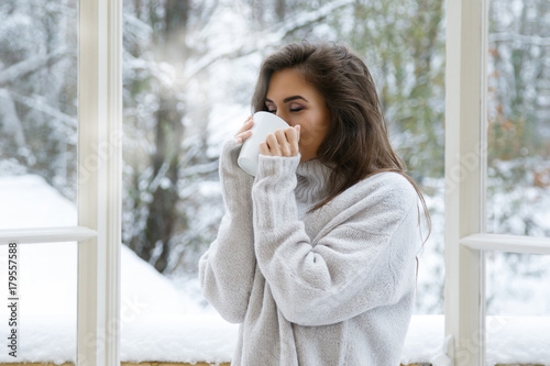 Woman with cup of hot drink