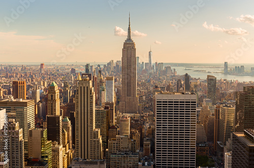 Manhattan Midtown Skyline with illuminated skyscrapers at sunset Wallpaper Mural