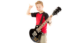 Pre-teen Boy And An Electric G...