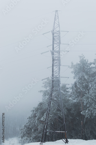 Valokuva  Winter photo of the high voltage transmission tower covered with hoarfrost stand