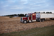 Semi And Trailer Waiting To Transport Crops