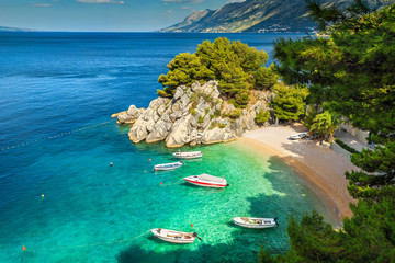 Tropical bay and beach with motorboats, Brela, Dalmatia region, Croatia