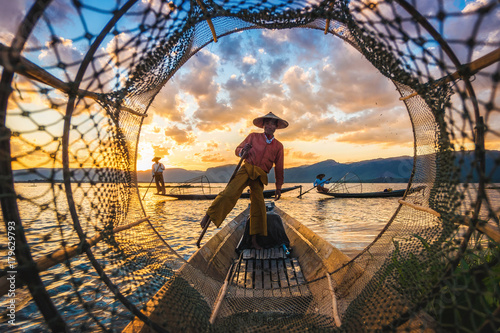 Intha fishermen at sunset, Inle Lake, Myanmar Wallpaper Mural