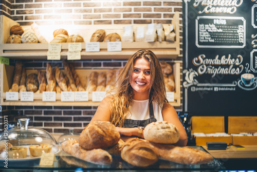 Woman sells in bakery.