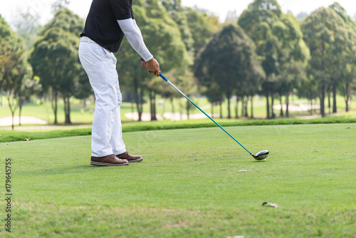 In de dag Ontspanning Asian golfers hit sweeping and keep golf course in the summer for relax time,soft focus and blurry