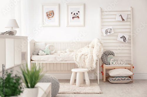 Fotografia  Baby bedroom decorated with pictures of animals