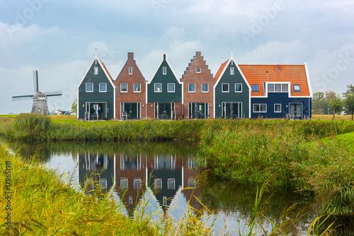 Foto auf AluDibond Stadt am Wasser Volendam is a town in North Holland in the Netherlands. Colored houses of marine park in Volendam. North Holland, Netherlands..