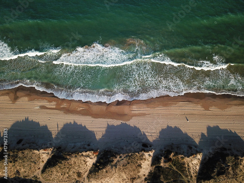 View of the sandy beach from the air Plakat