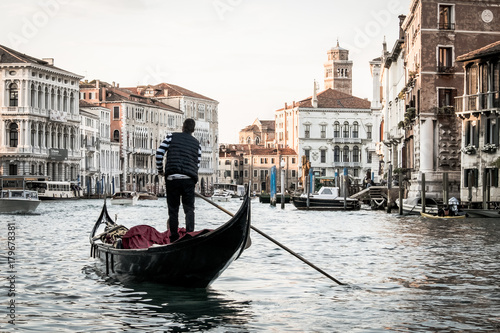 Aluminium Prints Venice Italian street on water, Beautiful nooks in Venice, Night view of canal in venice, Man on gondola in Venice, Young man in boat carrying tourists in Italy, Venetian taxi on water