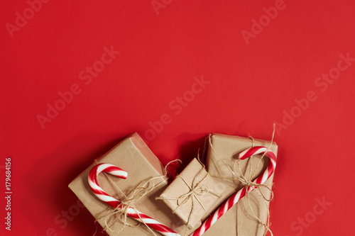 Christmas gifts on hot red background. Christmas and New Year theme ...