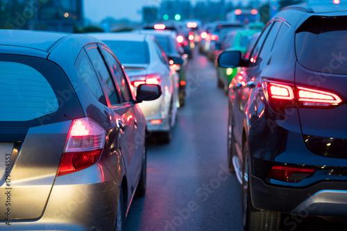 Foto op Aluminium Nacht snelweg Cars on urban street in traffic jam at twilight