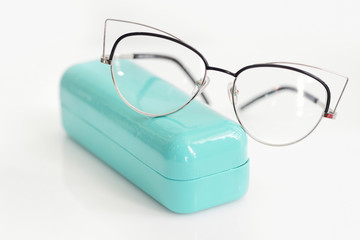 Glasses case with fashionable glasses on white background