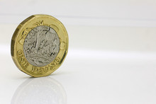 Pound Coin On A Reflective Whi...