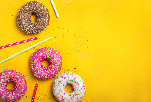 Tuinposter Dessert Yellow dessert background with various donuts