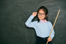 Confident Smart Little Girl Dressed As Teacher