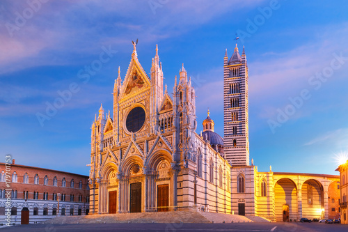 Fotografie, Obraz Beautiful view of facade and campanile of Siena Cathedral, Duomo di Siena at sun