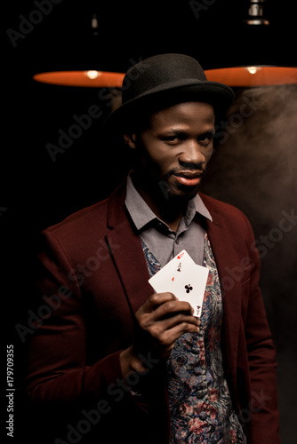 african american man with playing cards плакат