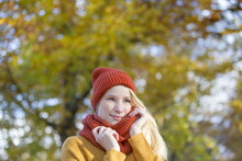 Portrait Of A Pretty Blonde Woman In Park In Autumn