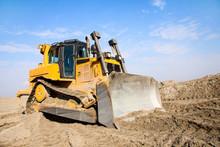 The Bulldozer Works On A Sandy...
