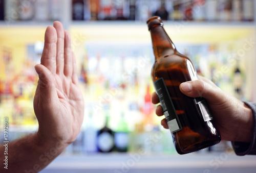 Hand rejecting alcoholic beer beverage bottle Canvas-taulu