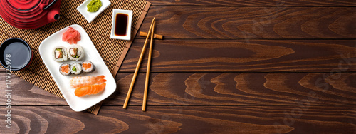 Poster Sushi bar Set of sushi with red teapot and chopsticks