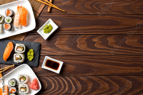 Poster Sushi bar Set of Japanese sushi on wooden table. Top view