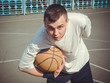 Portrait of cripple basketball player on open gaming ground. Athlete disabled play in basketball