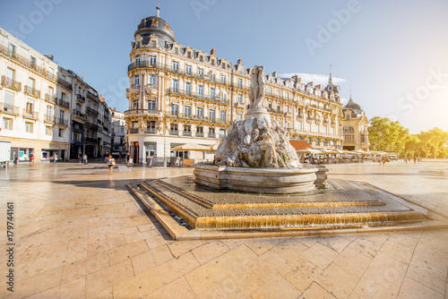 Papiers peints Con. ancienne View on the Comedy square with fountain of Three Graces during the morning light in Montpellier city in southern France