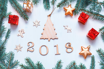 New Year 2018 background with 2018 figures,Christmas toys, blue fir branches. New Year 2018 composition