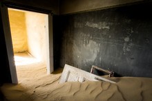 Abandoned House Covered In Sand