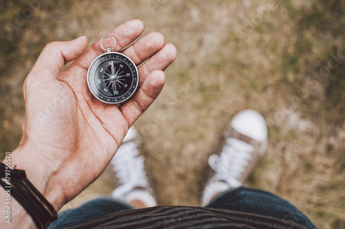 Traveler holding compass in hand