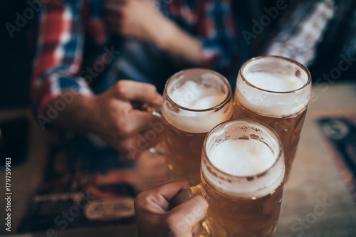 Canvas Prints Beer / Cider people, men, leisure, friendship and celebration concept - happy male friends drinking beer and clinking glasses at bar or pub