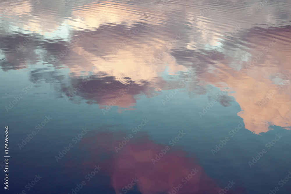 Fototapeta reflection of blue sky with white clouds in water, abstract background.