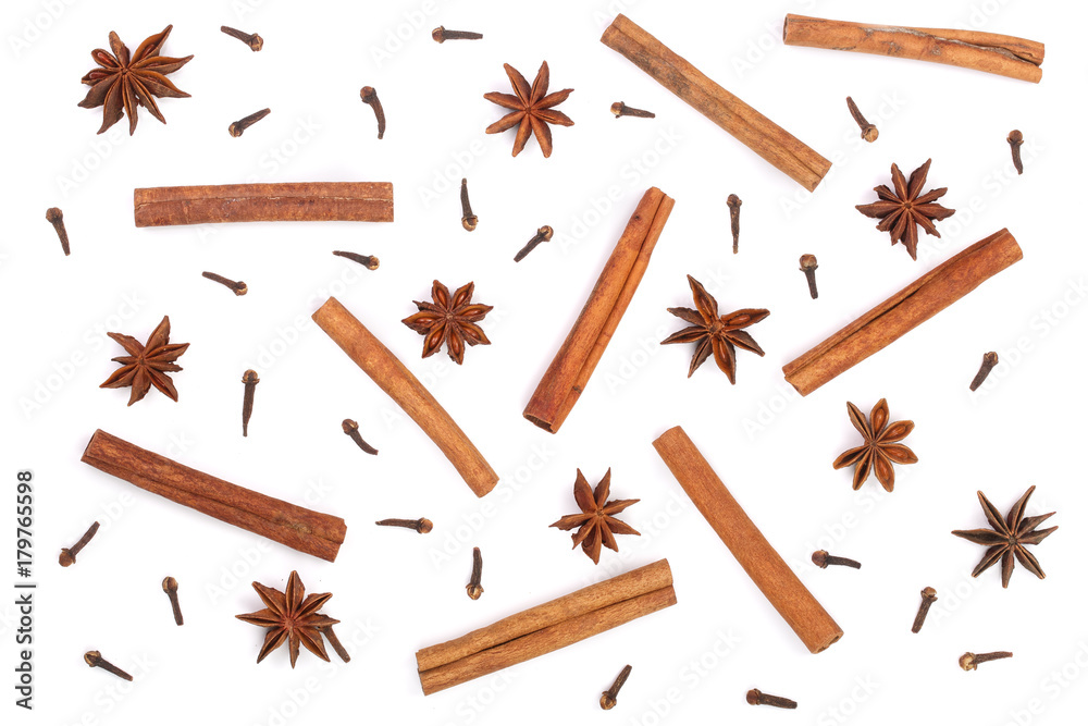 Obraz Composition of star anise, cinnamon sticks and clove isolated on white. Abstract pattern flat lay, top view fototapeta, plakat