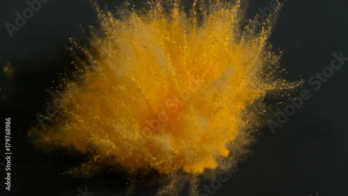 Amazing background of yellow holi powder being thrown