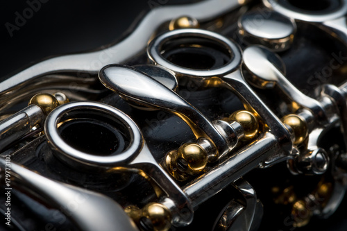 Canvas Details of a clarinet with silver keys and golden sockets