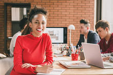 Black Business Woman In Casual Red Top At Office Meeting
