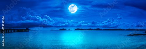 Panorama of sky with full moon on seascape to night.