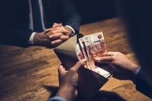 Businssman Counting Rubles In Envelope In Dark Room.
