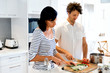Couple cooking together at home