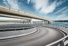 Asphalt Road And Highway Bridge Under The Blue Sky
